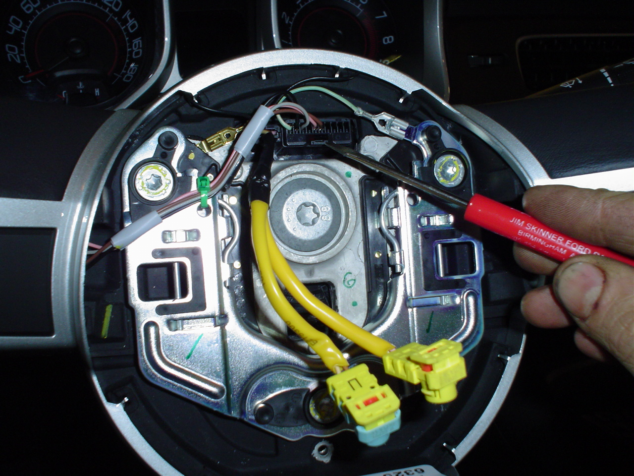 Now remove the torx and gently work your steering wheel out remamber the way it went out so you can put it back in the same spot set the wheel on the